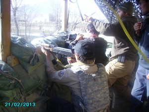 Members of a QRT team receive instruction during live-fire training.